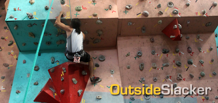 A climber tries to overcome an overhang